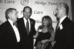 Eliot Spitzer and wife Silda with Rob Davis at Hedge Funds Care 2005