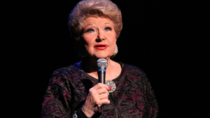"""I recently came across this article that I had stashed in a drawer a little over a year ago, when my cabaret guru, teacher, arranger and ass kicker Marilyn Maye was about to turn 88 years old. As of this writing, she's just swept past 89. Yes, you heard that right. While most people in their late 80's are waiting for the reaper, Marilyn is out there headlining in top venues, for packed houses of cabaret lovers, who appreciate being blown out of their seats by still, one of the most charming, captivating and outright dynamic performers of the past…well…almost 90 years! More importantly, Marilyn is a truly nice person who is wonderful to work with. Case in point, I met her at an """"open mic"""" she that was attending in support of her friend in the summer of 2014. I learned that she gave Master Classes and private lessons and the rest is history. I feel that I've grown as both performer and songwriter by working with her since. Not surprisingly in fact, she is quite brilliant when it comes to getting the most out of a song, and renown for the way she 'finishes"""" leaving audiences gasping and pleading for more. There are few performers who can say, as is true for her, that no audience has ever wanted a Marilyn Maye show to end. She's been called the greatest caucasian jazz singer ever. By I might add, the greatest black jazz singers ever. I call her the female Sinatra for how comfortable and cool she is on the stage. Its the quality that I strive for in my performances, along with every other singer. Very few make that grade, but she is a the best role model one could have, and the bar is set high by her example. Lucky me, I also get to appreciate the great contributions she has made to my original songs. It might be to request that I come up with a new verse, or to switch sections of the song around, or to suggest a more dynamic ending. They virtually always end up improving the dynamics and artistry of the song and when appropriate, I love seeing the words on my sheet musi"""