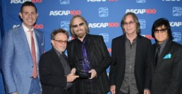 Petty accepts the ASCAP Founders Award from (l-r) ASCAP VP of Pop/Rock Membership Marc Emert-Hutner and President Paul Williams, Jackson Browne and ASCAP EVP of Membership John Titta